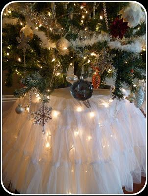 Lights under table....good idea for smaller trees