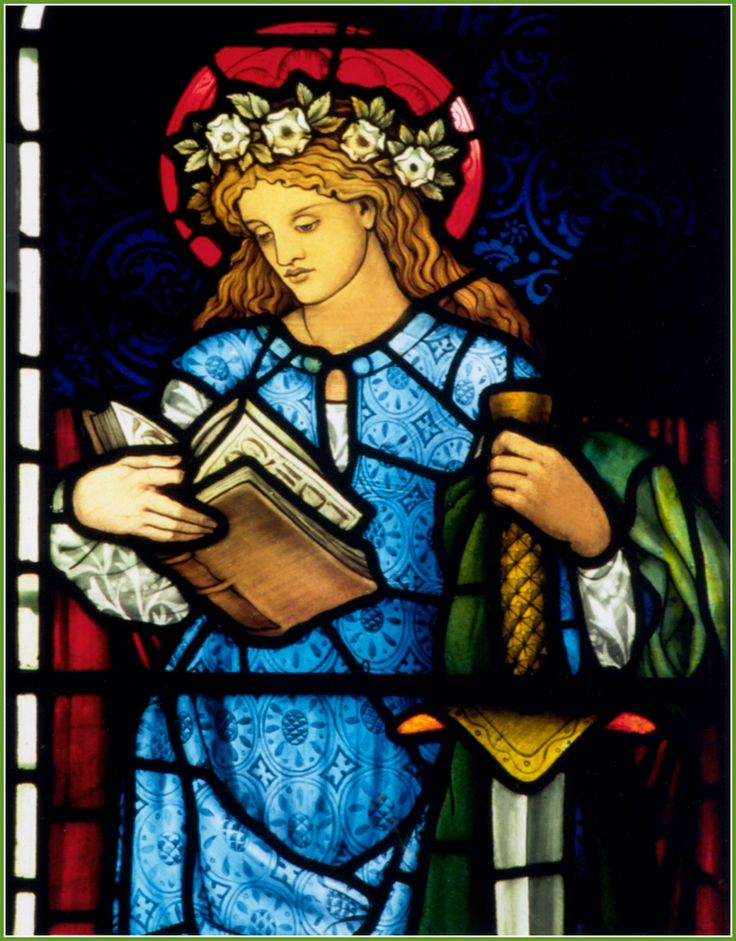 St. Catherine of Alexandria (patron saint of teachers), a stained glass window (detail). Depending on the source, this window was designed by Edward Burne-Jones, or possibly William Morris; and it was most likely made by Morris & Co. as early as 1860, or as late as the 1880s