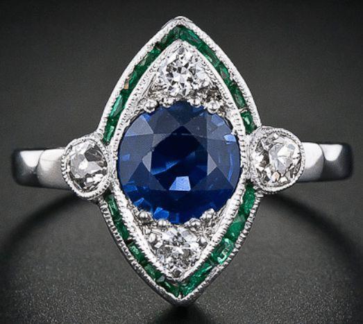 Art Deco navette-shaped emerald, sapphire, and diamond ring.