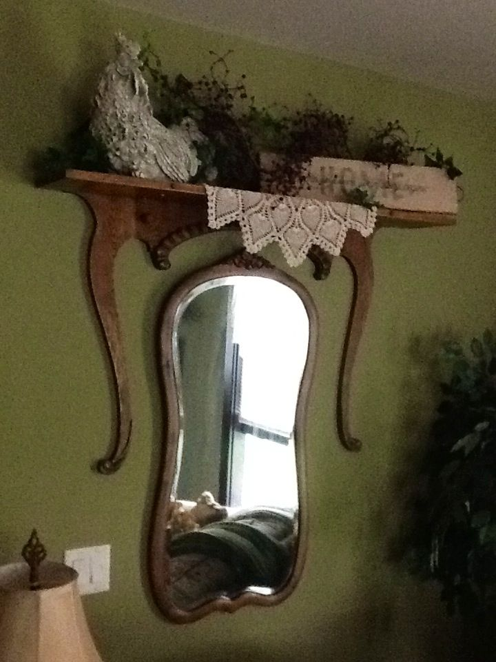 My sister made this shelf out of an antique dresser's harp, mirror and drawer.
