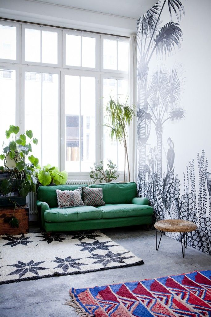 Real plants transition to painted on plants- love this mural.