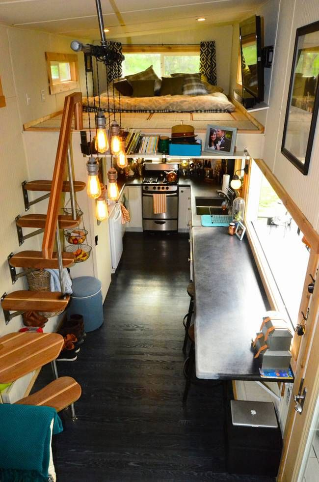 Built by tiny housers, this 224 sq ft abode looks almost like a regular-sized house, thanks to a few decisions: a regular-sized fridge, a generous countertop, and a lovely floating stair instead of a ladder. | TreeHugger | Tiny Homes