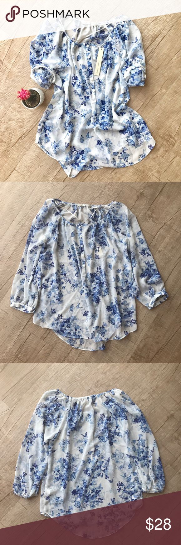 """Lauren Conrad Sheer Floral Print Peasant Blouse * LC Lauren Conrad Sheer Floral & Butterfly Printed Peasant Blouse * white with blue accents  * half button closure at front  * BUST (laid flat, on one side) - 19"""" * LENGTH - 25"""" * 100% Polyester * New with Tags  * no trades/paypal/off cite transactions * all measurements are approximate LC Lauren Conrad Tops Blouses"""