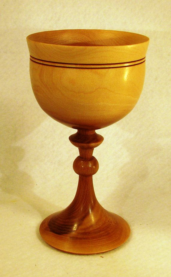 This is a lathe turned, hand made wooden chalice of beautiful sycamore wood. Its…