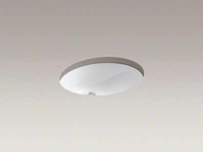 "Kohler:  Caxton round-ish undermount sink with center drain and GLAZED UNDERSIDE; #K-2205-G-0; finished height = 8-1/4""; bowl measures 17 x 14; msrp of $202.50:  Retailers: try Home Depot and Faucetdirect.com"