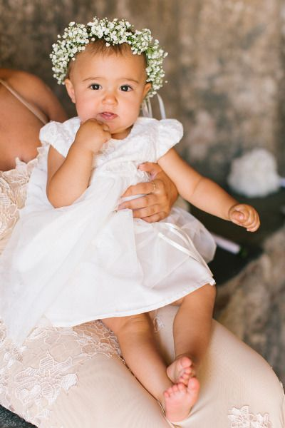 Sweet little flower girl: http://www.stylemepretty.com/little-black-book-blog/2014/10/30/organic-elegance-in-greece-at-kinsterna-hotel-spa/ | Photography: Anna Roussos - http://www.annaroussos.com/