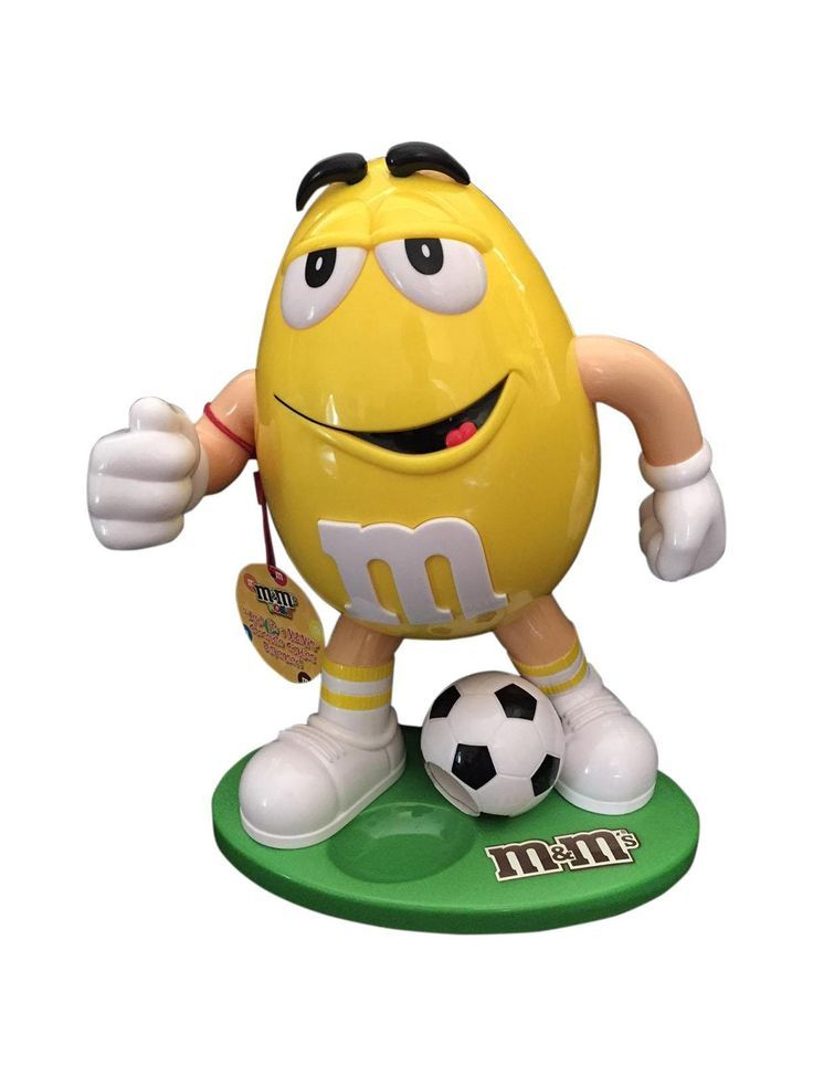 Yellow mm candy dispenser playing soccer the mm lovers in your family will adore having