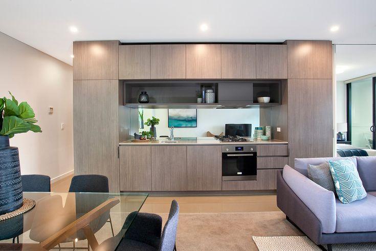 'The Gantry', caesarstone gas kitchen, dishwasher, mirrored splashback, dining table, lounge, Pilcher Residential