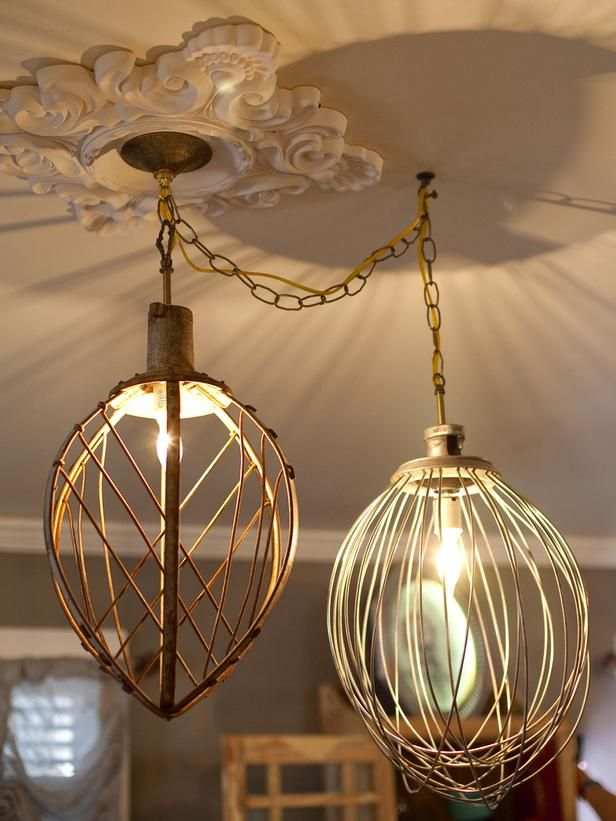 old restaurant mixer whisks turned into chandeliers for the GYPSY and the COWBOy living room on HGTV . .   {junk gypsy co, http://gypsyville.com/ }