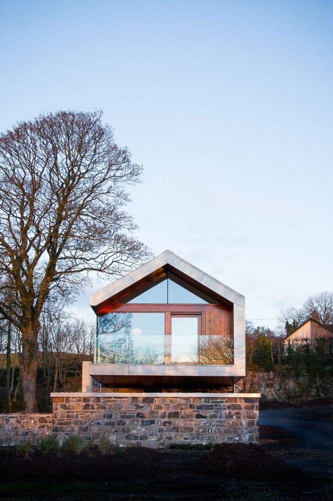 Granero de piedra transformada en una pintoresco Moderna Casa