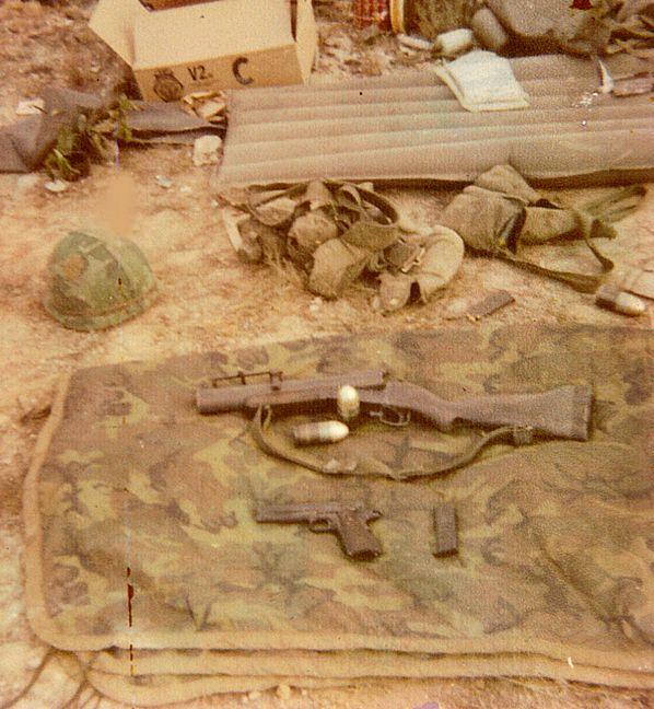 M-79 grenade launcher and .45 pistol