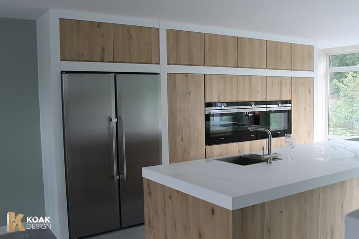 Ikea Kitchens with wooden doors from Koak Design --> werkblad Corian