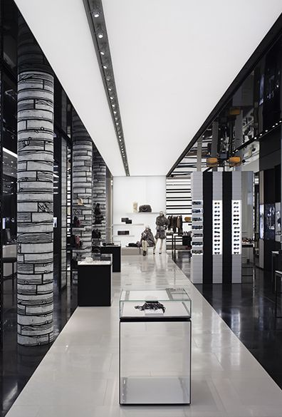 Chanel Soho by Peter Marino Architect. Like the colour schemes. Black sides framing the white centre.