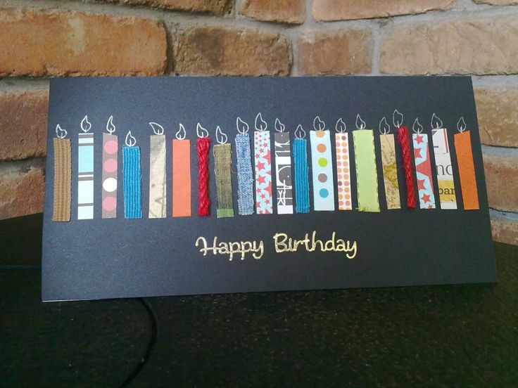 hand crafted birthday  card ... black ... short and wide format ... lots of candle from strips of patterned papers form a wide band across the front ... great use of scrap paper ... great card!