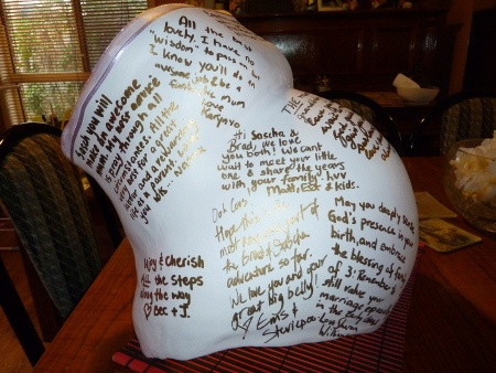 Make a belly cast the night before the shower and have all those in attendance at the Baby Shower sign it with wishes for baby or welcoming, etc. :)