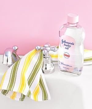 Baby oil as polish: Forget keeping skin soft, baby oil also polishes chrome. Apply a dab to a cotton cloth and use it to shine everything from faucets to hubcaps. You'll end up with shiny, happy surfaces from a medicine-cabinet staple. (Who actually owns chrome cleaner, anyway?)