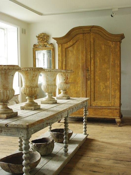 This picture depicts the Gustavian period. 18th century Gustavian armoire, antiques cast iron urns and table, Augustus Brandt Antiques