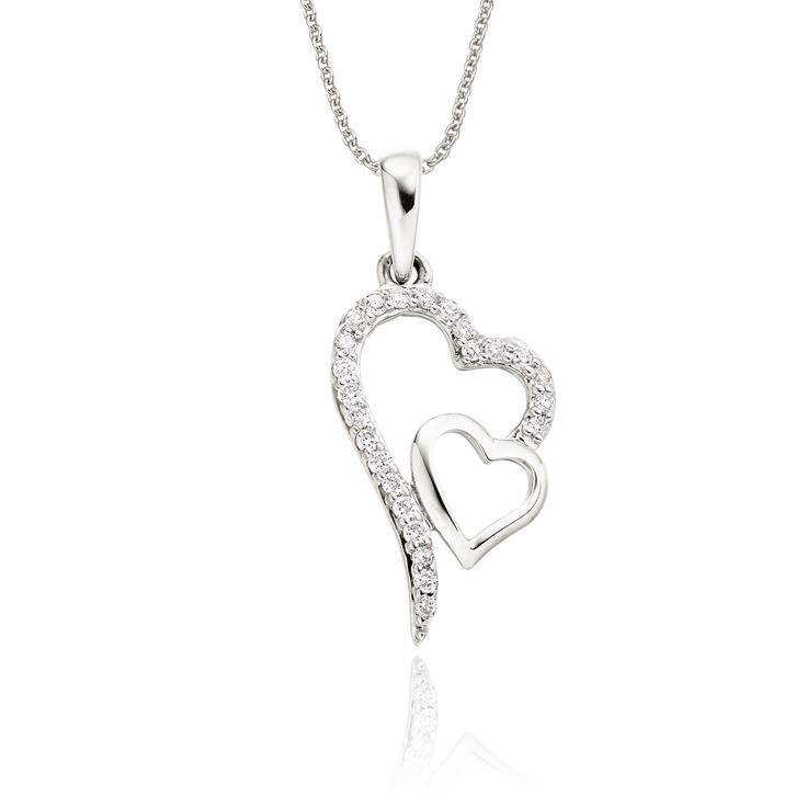 This elegant white gold diamond pendant has 0.12ct diamonds. The pendant features two interlocking hearts one beautifully polished and the other encrusted with round brilliant cut diamonds. This necklace is made in 9K white gold and is available complete with a beautiful mirror trace chain or if you already have a chain then you have the option to buy just the pendant.