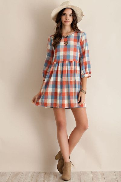 Limited edition super cute plaid printed baby doll style tunic dress, featuring chunky crossing straps in back. Dress is very lightweight and fully lined. Made