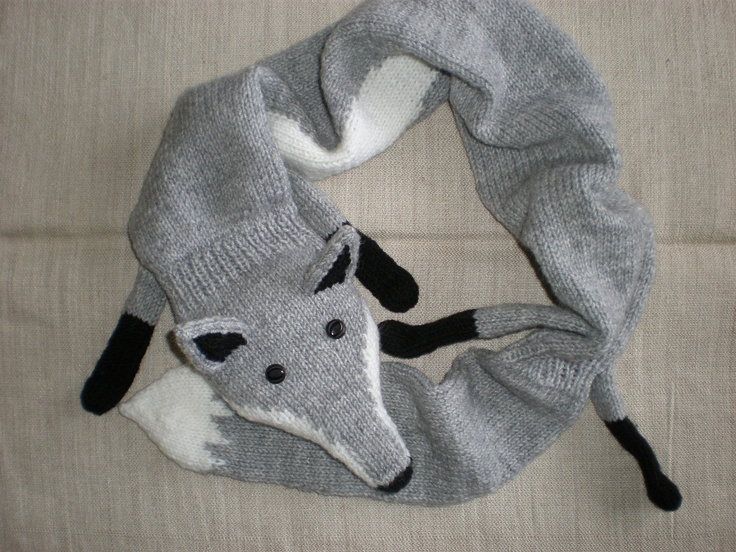 Hand-knitted light grey fox scarf.