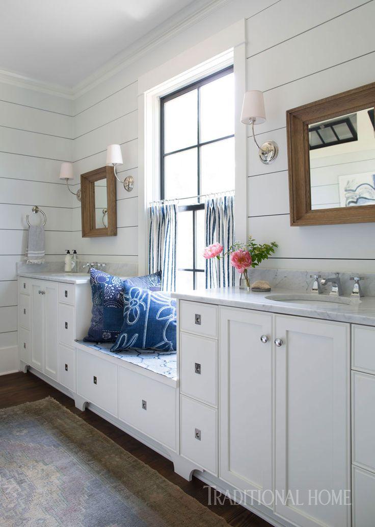 A petite window seat is sandwiched between twin vanities in the master bathroom. - Photo: Sarah Dorio / Design: Cloth & Kind