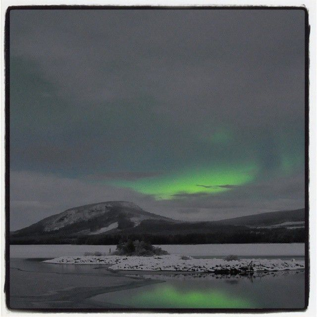 A northern light that makes it through the clouds in Sorsele Swedish Lapland