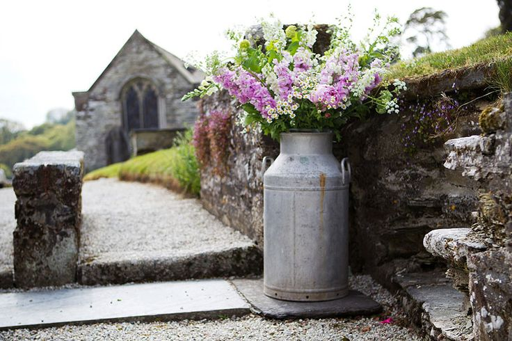 Milk churns in May by The Garden Gate Flower Company.
