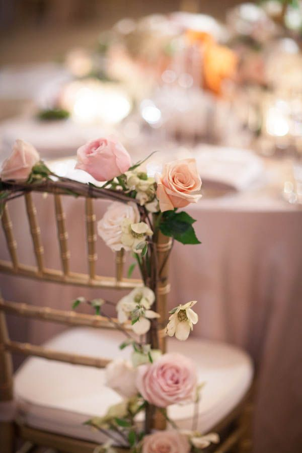 Wedding chair decor: floral garland lined wedding chairs with roses | romantic wedding reception ideas (Miki and Sonja Photography)