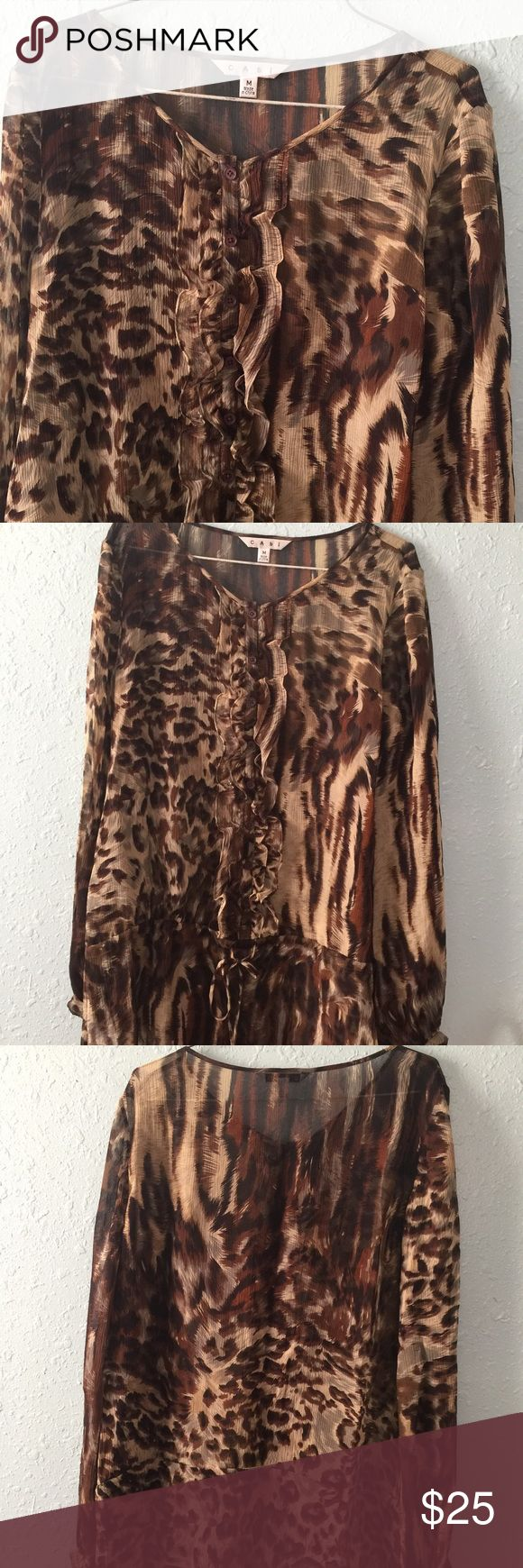 Semi-sheet leopard print blouse/top Lightweight print, ruffle front with buttons. Browns, black, and cream colored leopard pattern. Excellent condition, gently used CAbi Tops Blouses