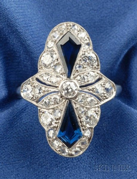 Art Deco Platinum, Sapphire, and Diamond Ring, designed as a navette, bezel-set with fancy-cut sapphires, further set with old European, old single, and rose-cut diamond melee, millegrain accents