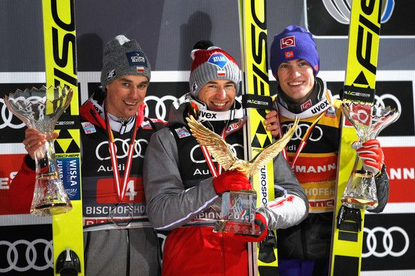 Kamil Stoch (C) of Poland celebrates winning the 65th Four Hills Tournament ski jumping event with Daniel Andre Tande (2nd Place, R) of Norway and Piotr Zyla (3rd Place, L) of Poland on Day 2 of the 65th Four Hills Tournament ski jumping event at Paul-Ausserleitner-Schanze on January 6, 2017 in Bischofshofen, Austria.