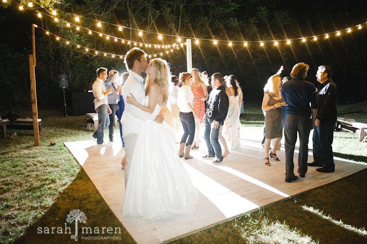 Backyard Wedding in Grass Valley, California - Couple on dance floor with market lights - Sarah Maren Photographers