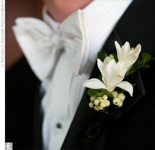 Blossoming tuberose boutonnière for the groom