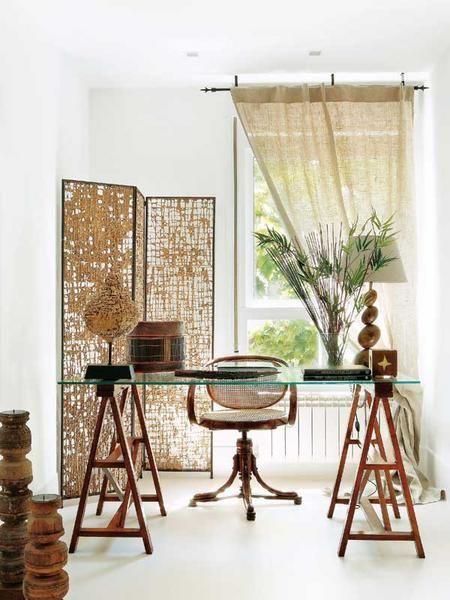 Vintage screen + sawhorse desk + white floors + beautiful light = a wonderful work space