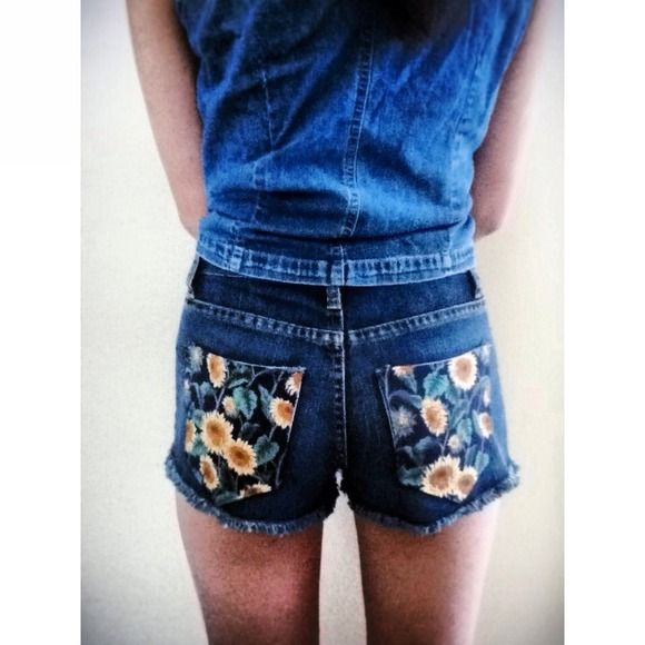Sunflower DIY Cutoff Shorts A pair of brand new without tags dark wash cutoff shorts with sunflower fabric pockets.  Jeans