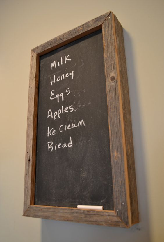 rustic framed chalkboard to hide an electric panel