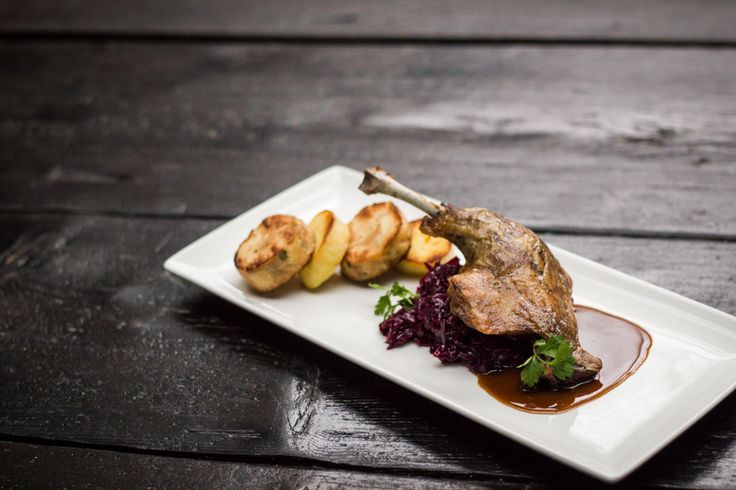 Confit duck leg, red cabbage with cranberries and variety of homemade dumplings. #epopey #fusionhotel #prague