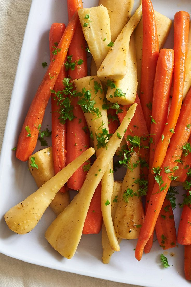 NYT Cooking: In this simple side dish, carrots and parsnips are simmered in a few pats of butter and a splash of water until tender, then hit with a dash of lemon juice and a sprinkling of fresh herbs. Use the smallest carrots and parsnips you can find