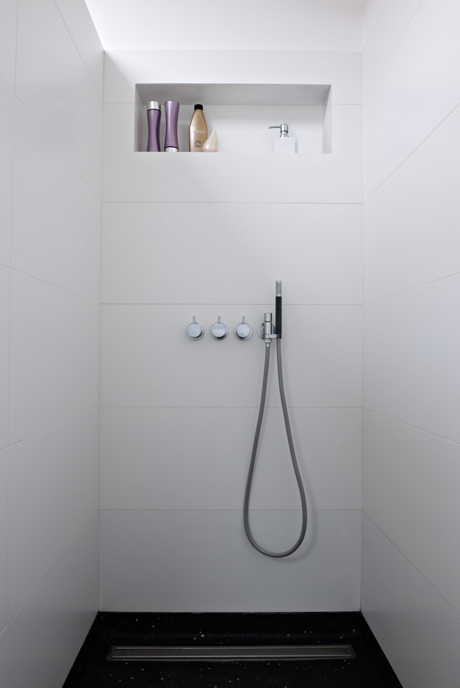 build in shower shelves are a must..