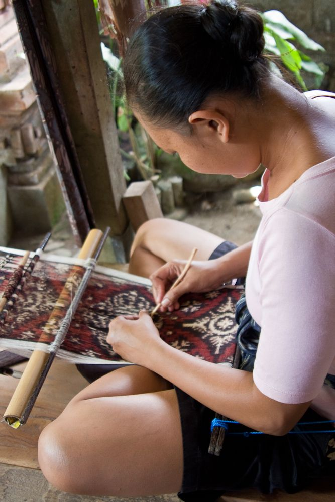 Registering the design during the weaving process. Tenganan, Bali.