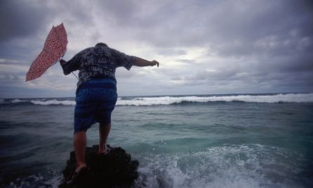 Bikenibeu Paeniu, Tuvalu's former two-time prime minister, faces the incoming swells of the South Pacific ocean