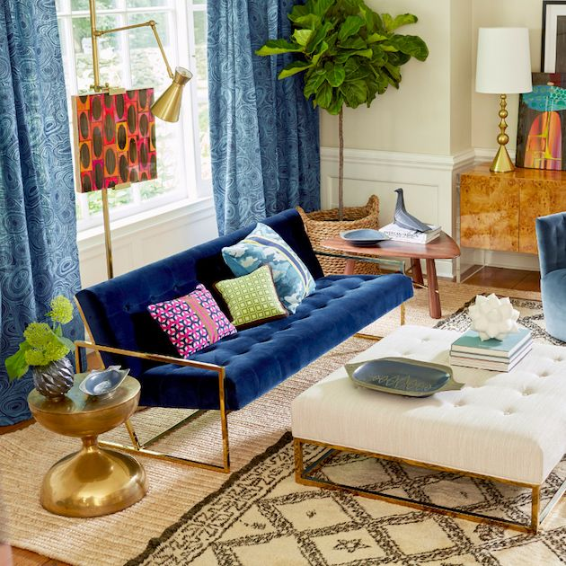 Designed by Jonathan Adler, Goldfinger is a velvet sofa that mixes contemporary with a little bit of the '70s. The combination of the rich blue with the gold details make this sofa a desired furniture piece that will make any living room set more sophisticated. SEE MORE: http://losangeleshomes.eu/luxury-homes-2/designer-sofa-ideas-stylish-living-room-set/
