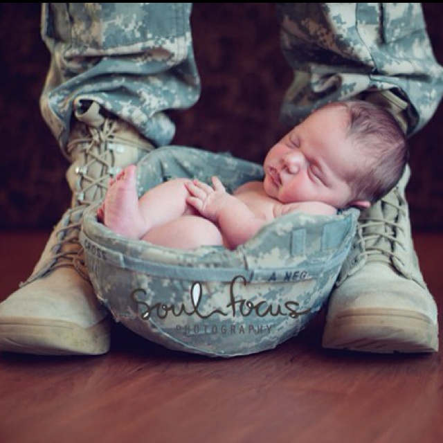 cute... could be done with any hat that the mom or dad work with... hard hat, police hat, fireman's helmet...