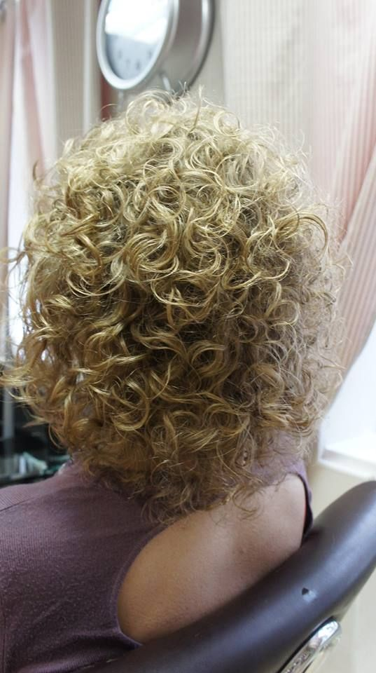 shorter perm style with very big curls