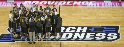 Wichita State players and coaches meet at center court at the Dunkin Donuts Center in Providence, R.I., on Wednesday.