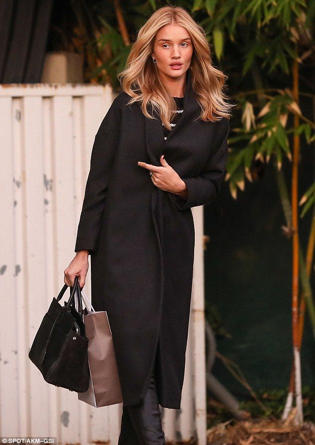 Blonde ambition:Rosie Huntington-Whiteley looked as gorgeous as ever on Monday as she stepped out in West Hollywood