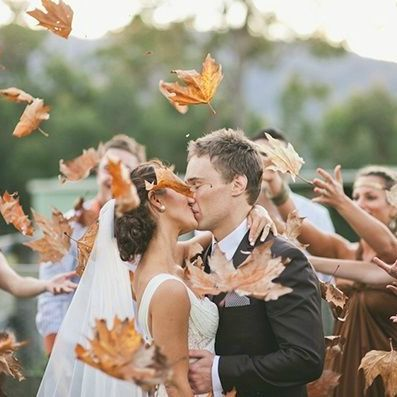 34 Stunning Fall Wedding Photos to Copy - Forget rice and sparklers. If you're having a fall wedding, have the bridal party toss leaves to get this magical shot.