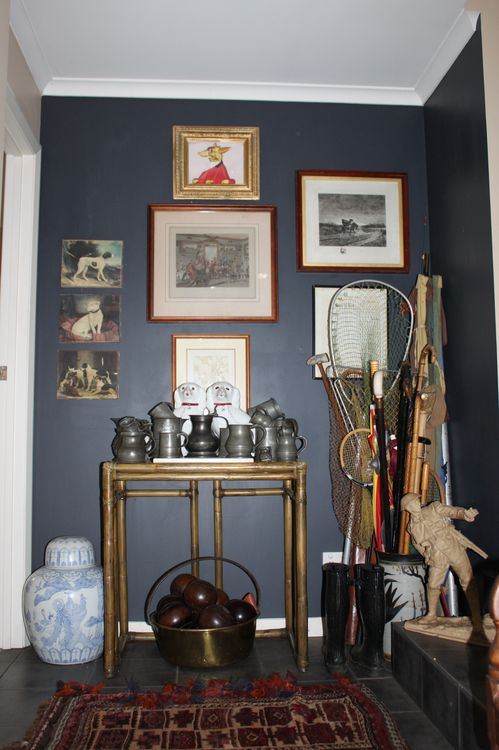 A collection of memorabilia is a tribute to Jill's late husband, set against walls in Resene Shark.