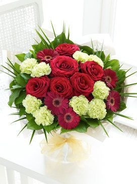 Interflora Majestic Hand-tied C00440MSI This is an exquisite bouquet that is guaranteed to make someone feel very special. We™ve chosen the finest large-headed Grand Prix roses to take centre stage and set them against deep red germinis and http://www.MightGet.com/january-2017-12/interflora-majestic-hand-tied-c00440msi.asp
