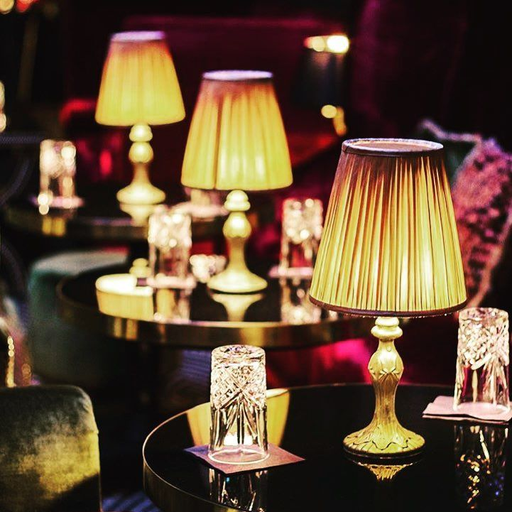 The Cordless Capiz Lamp Adding Ambience In A Bar Cordless Table Lamps Battery Operated Table Lamps Cordless Lamps